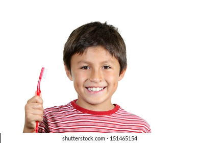Young boy brushing his teeth on white background