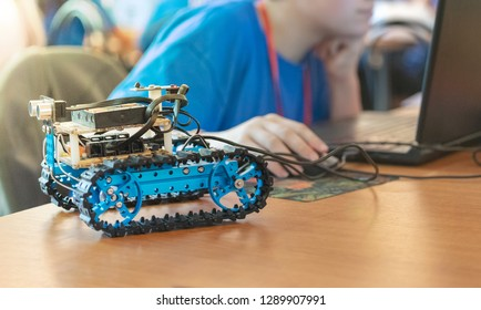young boy building a autonomous vehicle controlled by software