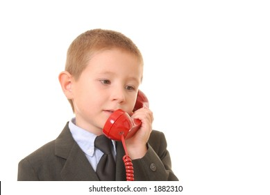 Young boy businessman talking on standard phone