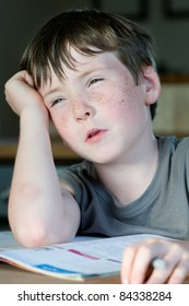 young boy calculated at homework or school