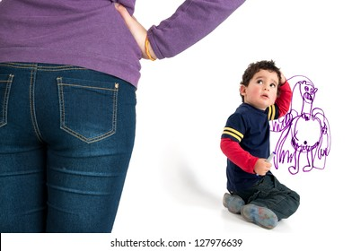 Young boy caught by his mother painting the wall