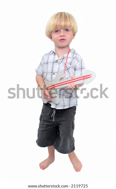 Young boy or child playing cardboard toy guitar with white isolated background
