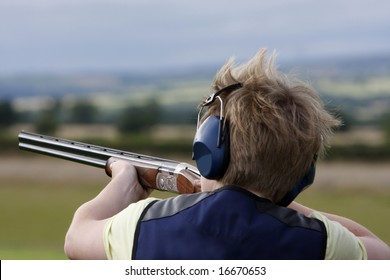 Young boy clay pigeon shooting