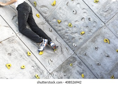 Young boy climbing a wall