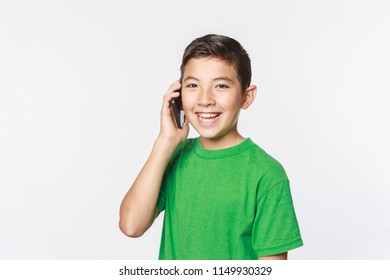 Young boy in a conceptual photo of talking on the cell phone.