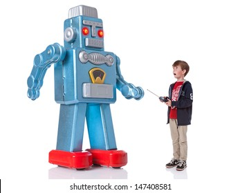 A young boy controlling a giant mechanical robot, isolated on a white background.