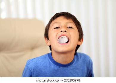 Young boy cooling down with ice in his mouth - shallow depth of field