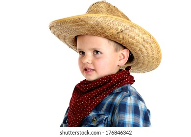 young boy in cowboy hat and bandanna