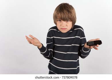 Young boy disappointed because he has a basic mobile phone only