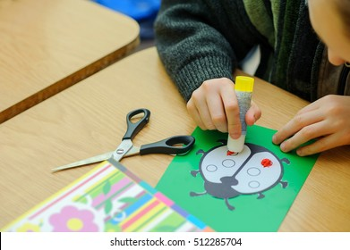 Young boy does hand-made crafts at school