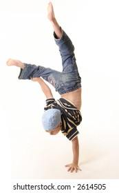 Young boy doing a one handed handstand with a white background