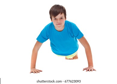 Young boy doing push ups - front view, isolated