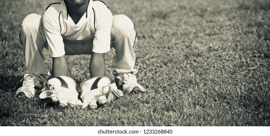 Young boy doing wicket keeping practice unique photo