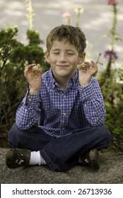 Young boy doing yoga exercise.