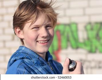 Young boy drawing graffiti