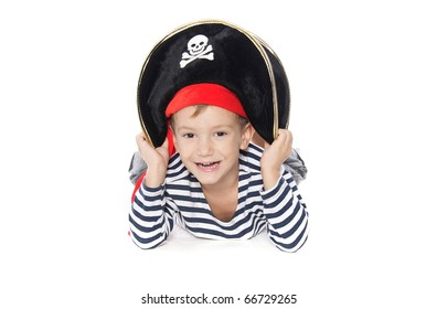 young boy dressed as pirate over white