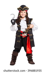 Young boy dressed as pirate posing with gun and hook. Isolated on white