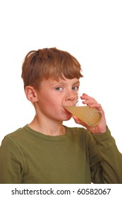 Young boy drinks some juice
