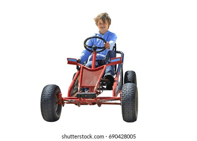 Young boy driving a Quadricycle isolated on white. Clipping Path