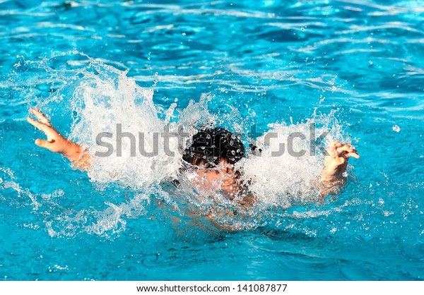 Young boy drowning in the pool