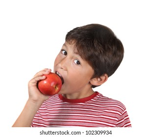 Young boy eating a red apple on a white background