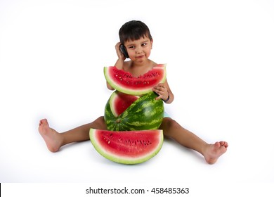 Young boy eating slice of watermelon