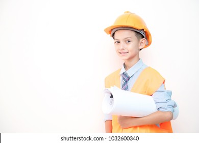 Young boy engineer isolated in white. Handsome early teenage boy portrait with engineering cloth. Holding a blue print.