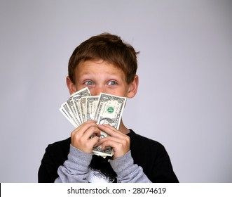 a young boy is excited by all the money he was just given