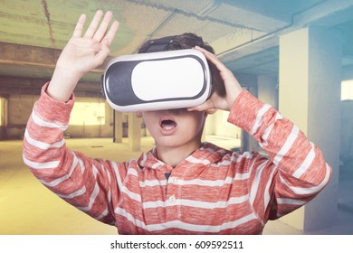 Young boy experiencing virtual reality
