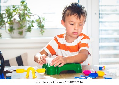 young boy experiments with different colors at home