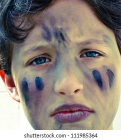 Young boy with face paint.
