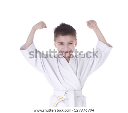Young boy fighter in kimono with hand up isolated on white background