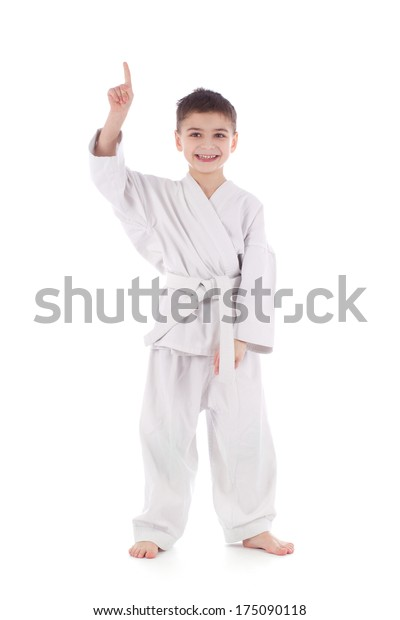 A young boy fighter in white kimono showing finger up isolated on white background