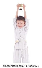 A young boy fighter winner in white kimono with cup isolated on white background