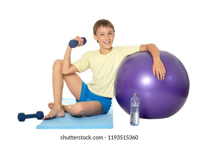 Young boy with fit ball and dumbbells
