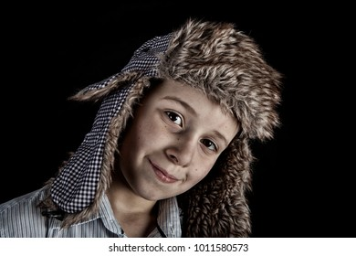 young boy in a fur hat