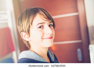 Young boy getting ready in the mirror before leaving home New day of ordinary life
