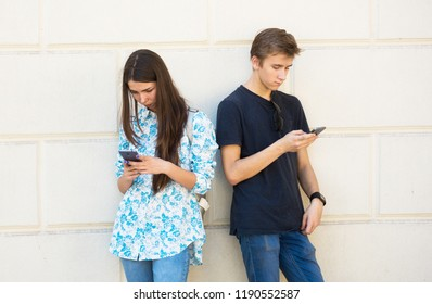Young boy and girl deep into virtual reality. Relationship's  problem concept.