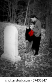 A young boy and girl grieve at a grave (color removed except for flowers)
