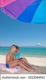 Young Boy Girl Playing Smartphone Beach shade