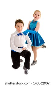 A Young Boy and Girl Tap Dance Partners in Recital Costume