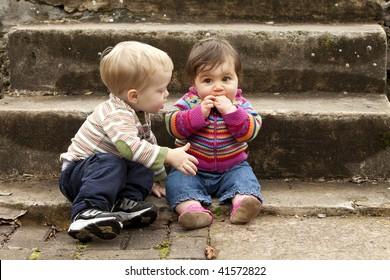 Young Boy Giving Sad Baby Girl a Hug