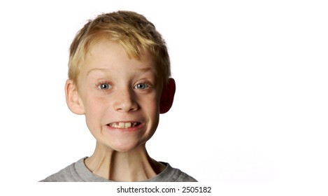young boy with goofy smile on white background