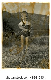 young boy at the grass field - summer time - vintage photo scan - about 1945