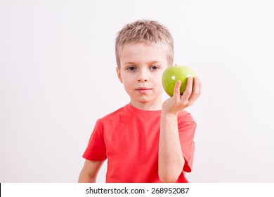 Young boy with green apple
