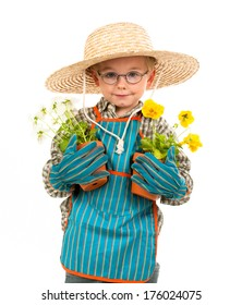 A young boy grins as he holds two potted plants, while wearing a large hat.