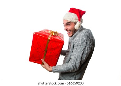 Young boy growling and holding a gift or stealing a gift isolated on white background