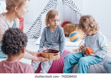 Young boy guessing vegetable names during educational classes in kindergarten