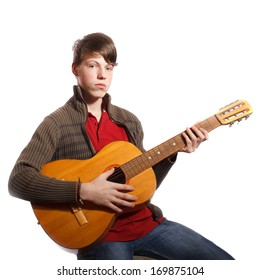 young boy with guitar on white background