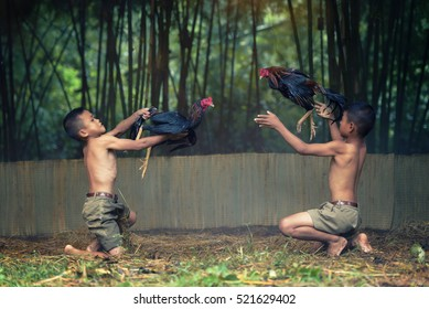 young boy happiness play cockfighting in traditional local thai